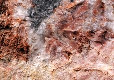 La pietra rossa con in bianco e nero spruzza Immagini Stock Libere da Diritti