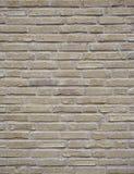 La pieza de la pared de ladrillo amarilla de la nata con el cemento articula Fotografía de archivo libre de regalías