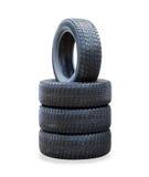 La pila de cuatro nuevos neumáticos del invierno Imagen de archivo libre de regalías