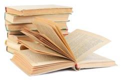 La pila de libros aislados en blanco fotografía de archivo libre de regalías