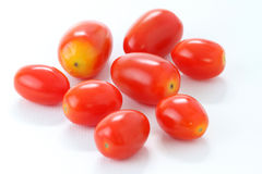 La pila de Roma Tomatoes aisló en el fondo blanco, macro Imagen de archivo libre de regalías