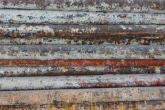 La pila de tubo le gusta una pared para el fondo Fotografía de archivo libre de regalías