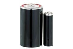 La pila a secco nera D ed aa gradua la batteria secondo la misura nel nero fotografia stock libera da diritti