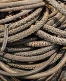 La pile de porter font du vélo des pneus Photo libre de droits