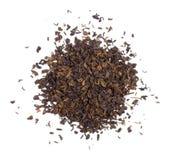 La pile des feuilles de thé sèches. Image stock