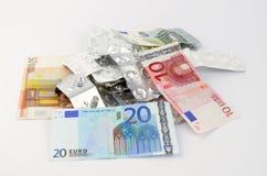 La pillola riduce in pani la bolla e l'euro Fotografia Stock