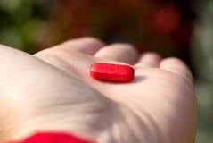 La pillola rossa Fotografie Stock