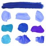La pintura azul mancha el sistema del VECTOR Imágenes de archivo libres de regalías