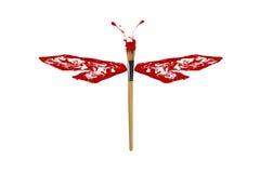 La pintura blanca roja hizo la libélula Fotos de archivo