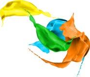 La pintura coloreada salpica aislado en el fondo blanco Imagen de archivo libre de regalías