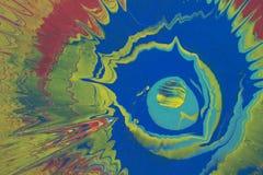 La pintura de la mostaza, azul y roja salpica Imagen de archivo