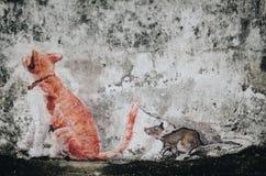 La pintura del gato y de la rata en la pared fotos de archivo libres de regalías