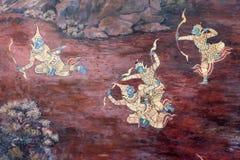 La pintura del ramayana en templo público en Tailandia Foto de archivo libre de regalías