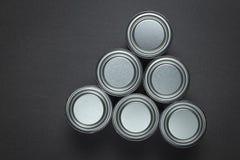 La pintura metálica estaña el arreglo en gris fotos de archivo libres de regalías
