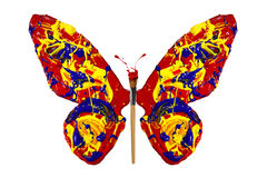 La pintura y la brocha hicieron la mariposa Imagen de archivo libre de regalías