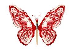 La pintura y la brocha rojas blancas hicieron la mariposa Imagen de archivo libre de regalías