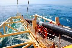 La pipe de gaz entre dans la mer Photographie stock libre de droits