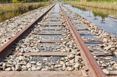 La pista ferroviaria inundada Foto de archivo libre de regalías