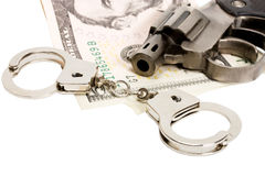La pistola ammanetta i soldi Immagine Stock