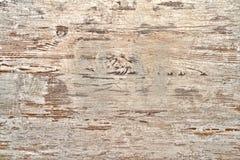 La pittura bianca della vecchia sbucciatura su legno si imbarca sul fondo Immagini Stock