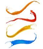 La pittura colorata spruzza su fondo bianco immagini stock libere da diritti
