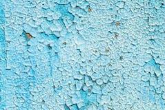 La pittura scheggiata sulla parete dei bordi anziani struttura il fondo Fotografia Stock Libera da Diritti