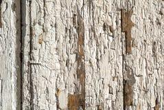 La pittura scheggiata sulla porta dei bordi anziani struttura il fondo Immagine Stock Libera da Diritti