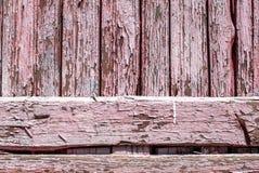 La pittura scheggiata sulla porta dei bordi anziani struttura il fondo Fotografia Stock Libera da Diritti
