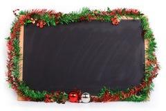 La pizarra adornó día de la Feliz Navidad Fotos de archivo