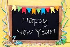 La pizarra con la decoración del partido, manda un SMS a Feliz Año Nuevo Fotografía de archivo libre de regalías