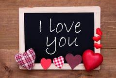 La pizarra con los corazones de la materia textil, manda un SMS te amo Fotos de archivo