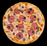 La pizza con el salchichón, setas y jamón, aisló Fotografía de archivo libre de regalías