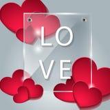 La placa de cristal con los corazones Foto de archivo libre de regalías