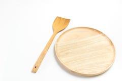 La placa o la bandeja de madera con la aleta o la espada aisló el fondo blanco Fotografía de archivo libre de regalías
