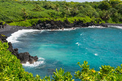 La plage chez Wai'anapanapa, Maui Photo stock