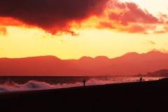 La plage de coucher du soleil Image stock