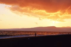 La plage de coucher du soleil Images libres de droits