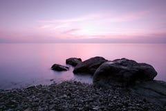 La plage en soirée Photographie stock libre de droits