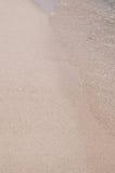 La plage sablonneuse, se ferment  Photographie stock