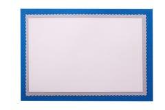 La plantilla azul de la frontera de la tarjeta de Navidad aisló el espacio blanco de la copia imagenes de archivo