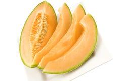 la plaque de cantaloup a découpé en tranches Images stock