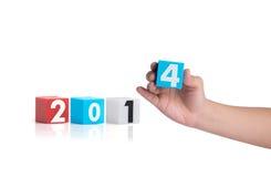La plastica variopinta dell'anno numera su un fondo bianco Fotografia Stock