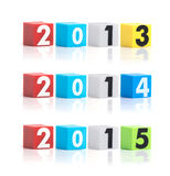 La plastica variopinta dell'anno numera su un fondo bianco Fotografia Stock Libera da Diritti
