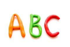 La plastilina pone letras a ABC Imágenes de archivo libres de regalías