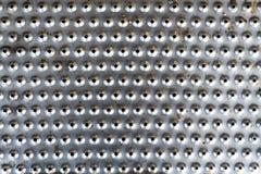 La plata agujerea vieja textura del fondo del metal Fotografía de archivo libre de regalías