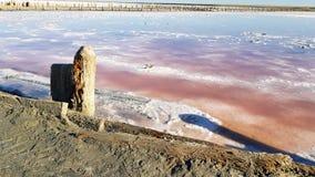 La playa de Sandy agita la arena roja fotografía de archivo libre de regalías