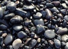 La playa del océano empiedra el fondo Imagen de archivo