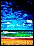 La playa en colores saturados Foto de archivo libre de regalías