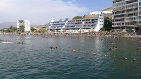 La playa y algunos edificios exteriores en Ancon Foto de archivo libre de regalías