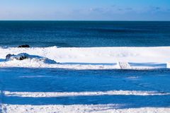 La playa y la nieve Imagen de archivo libre de regalías